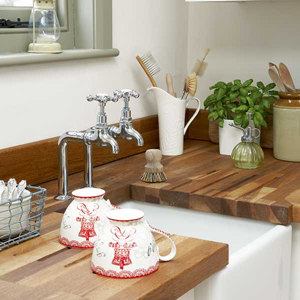 undermounted Belfast sink with wooden worktops in cottage style kitchen
