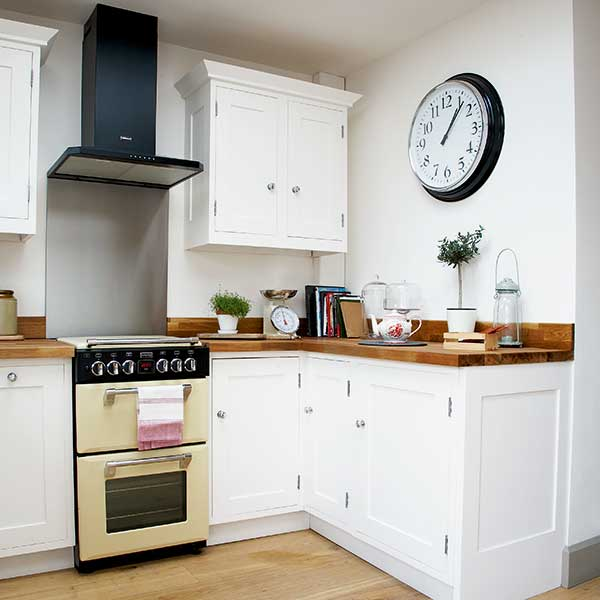 white and wood kitchen with retro cooker