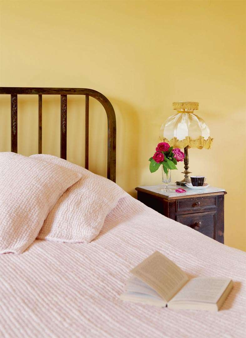Colourful yellow bedroom