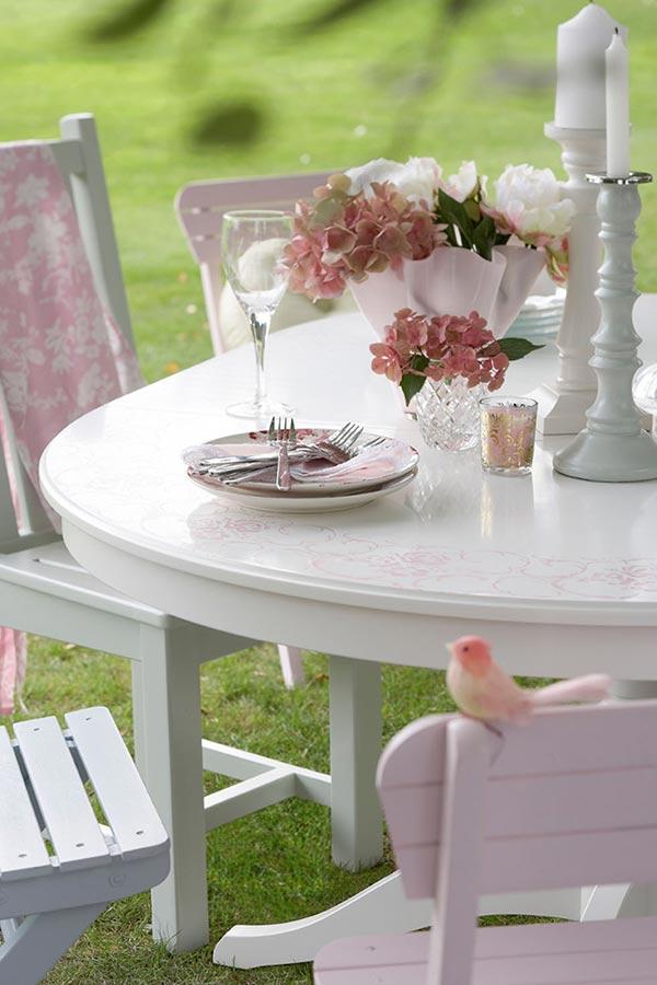 outdoor dining area painted in cuprinol's garden shades