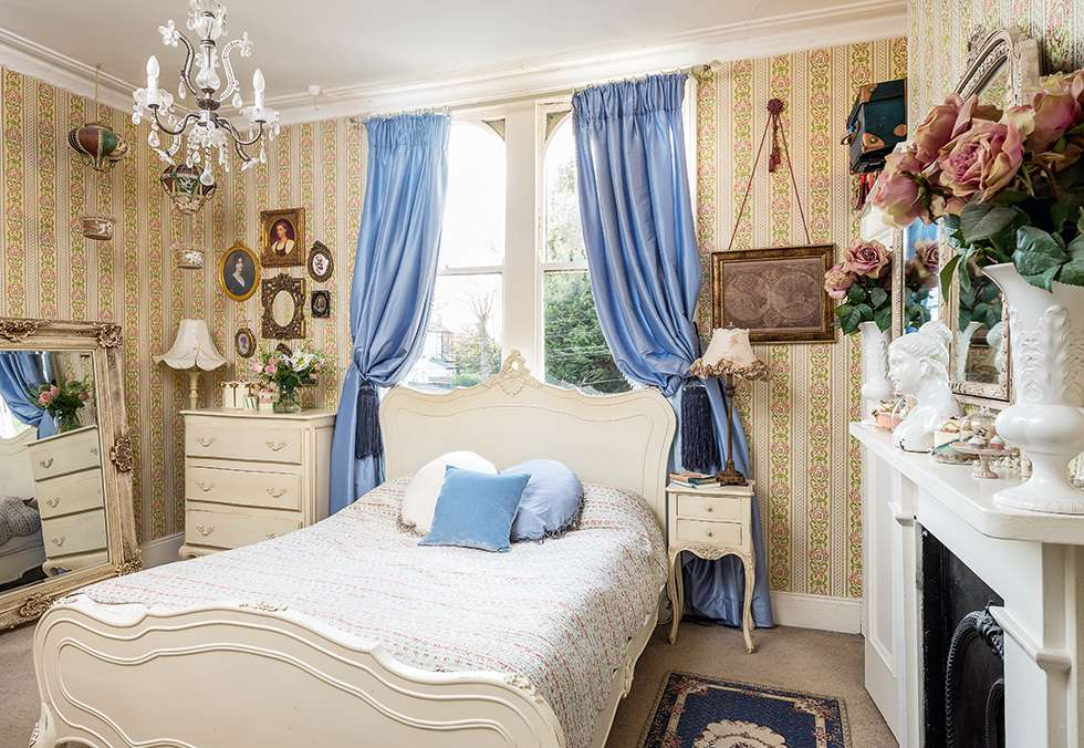 Spare bedroom decorated with wallpaper