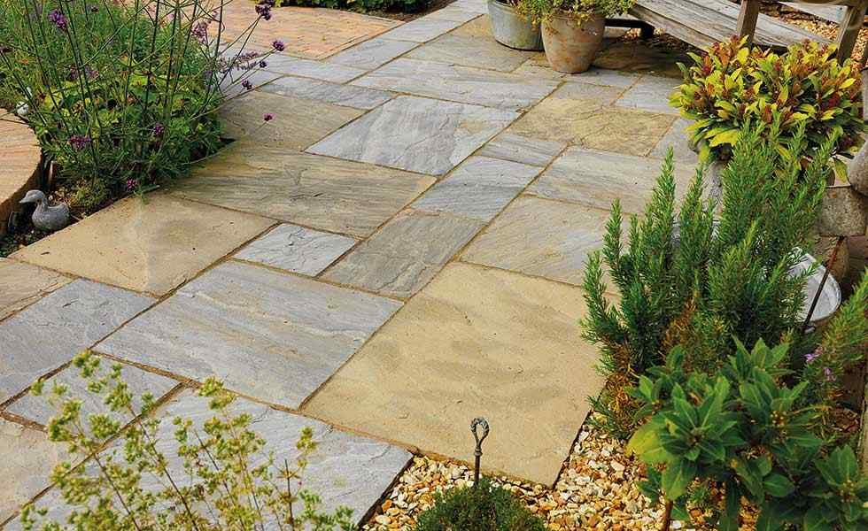 Pavestone Old Black Paving stones in a garden