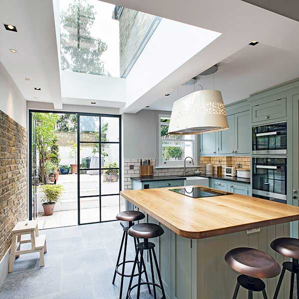 Chris Dyson side return kitchen-diner with rooflight and Crittal doors