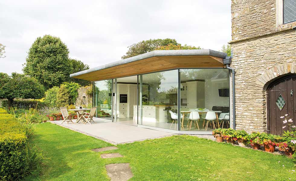 Tom Howley contemporary extension to Gothic stone house