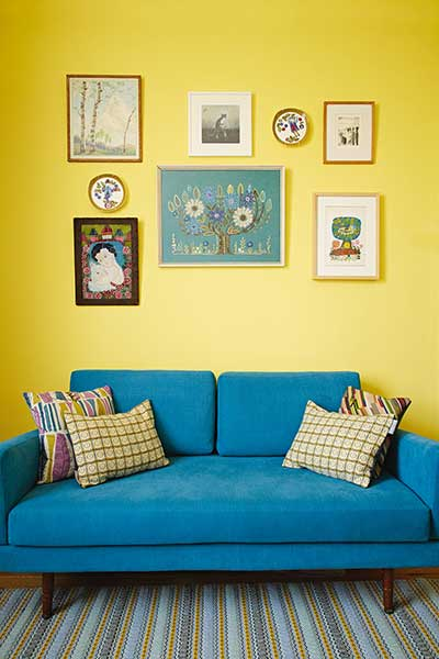 Victorian pattern house blue sofa yellow walls