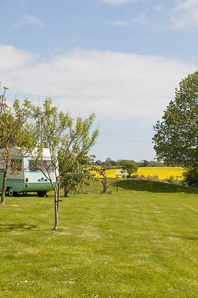 listed barn conversion caravan in garden field rural country