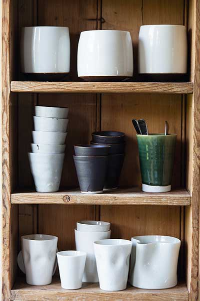 listed barn conversion ceramic collection on shelving