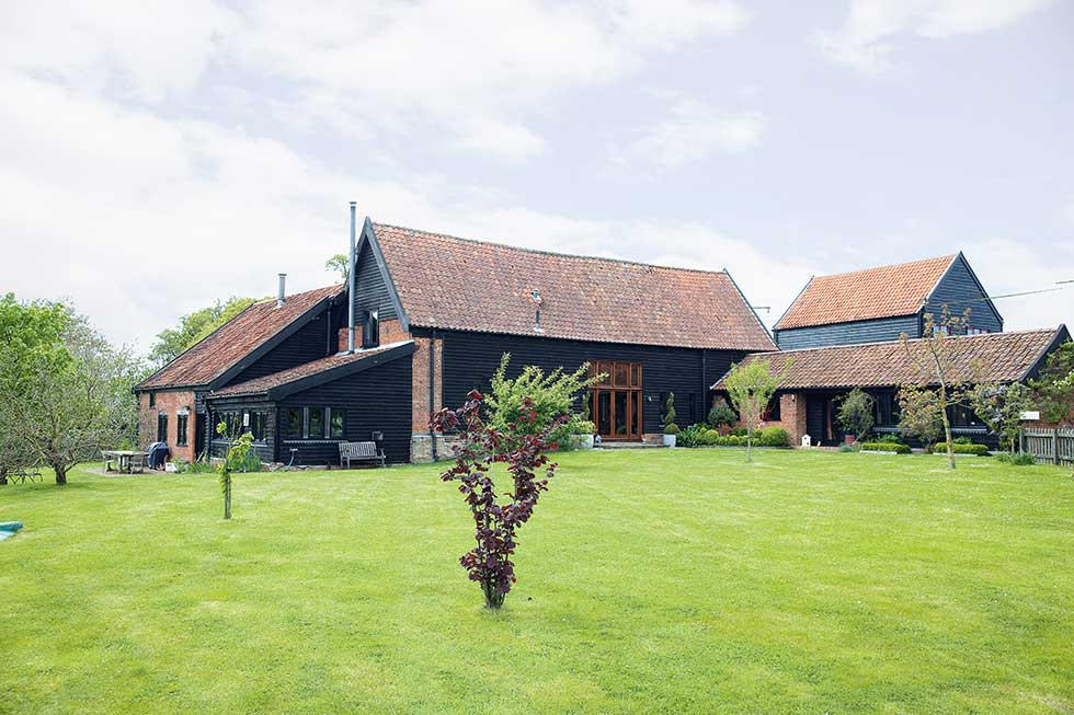 listed barn conversion exterior timber with pantiles