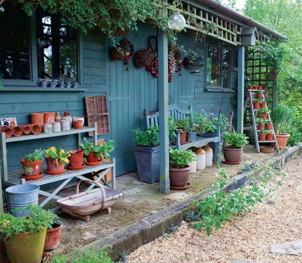 Blue garden rooms act as a garden designers workshop