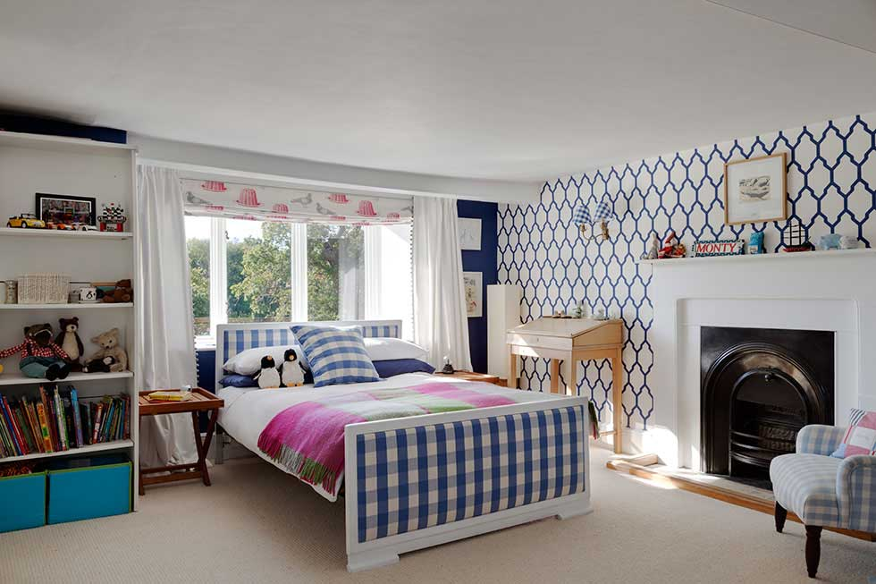 bedroom with patterned wallpaper in a grand country house