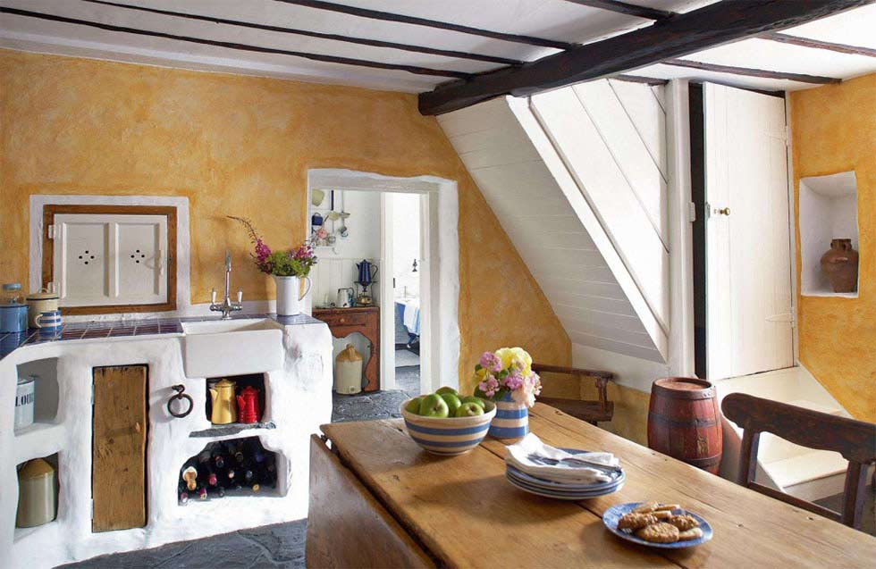 a restored thatched cottage with a colourful interior