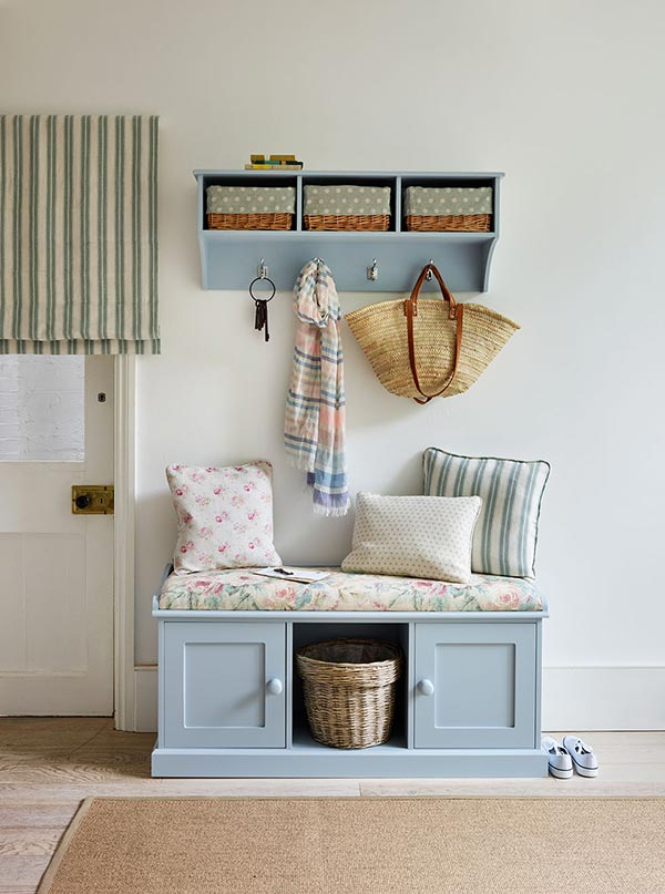 light blue low cupboards in hallway bench