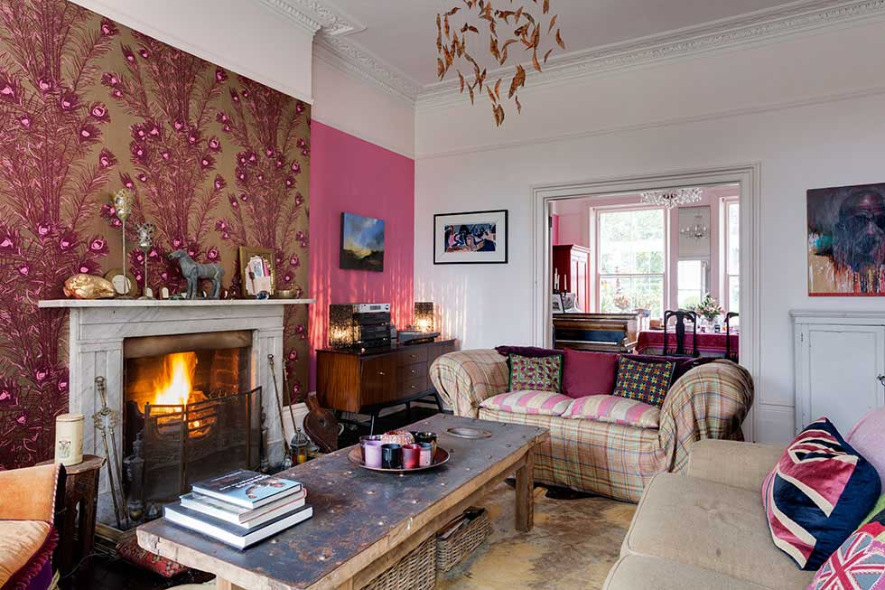 marble fireplace in a colourful victorian villa