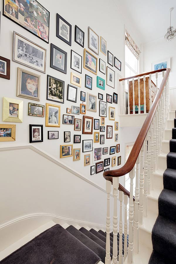 displayed pictures stairwell in a colourful Victorian villa