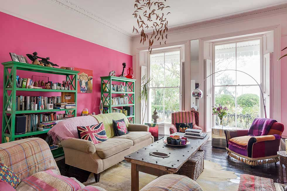 livingroom seating in a colourful victorian villa