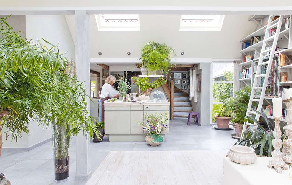 the hallway and an open air kitchen living area