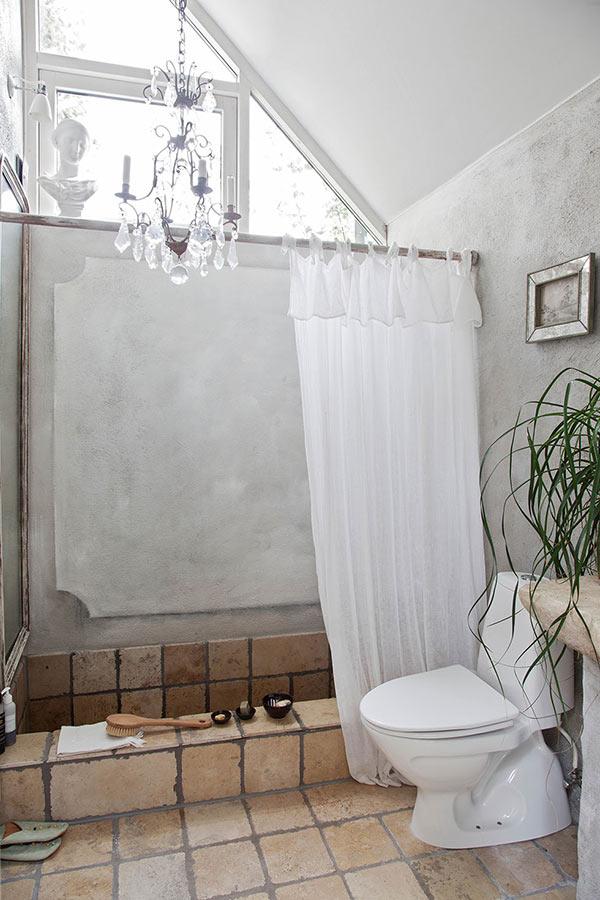 roman style sunken bath in a country retreat