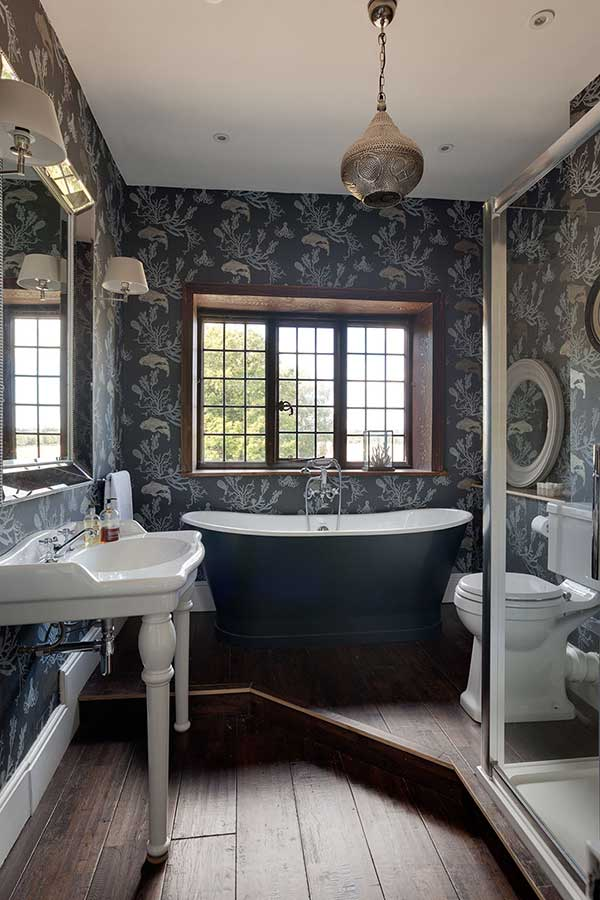 dark victorian style country bathroom with a step