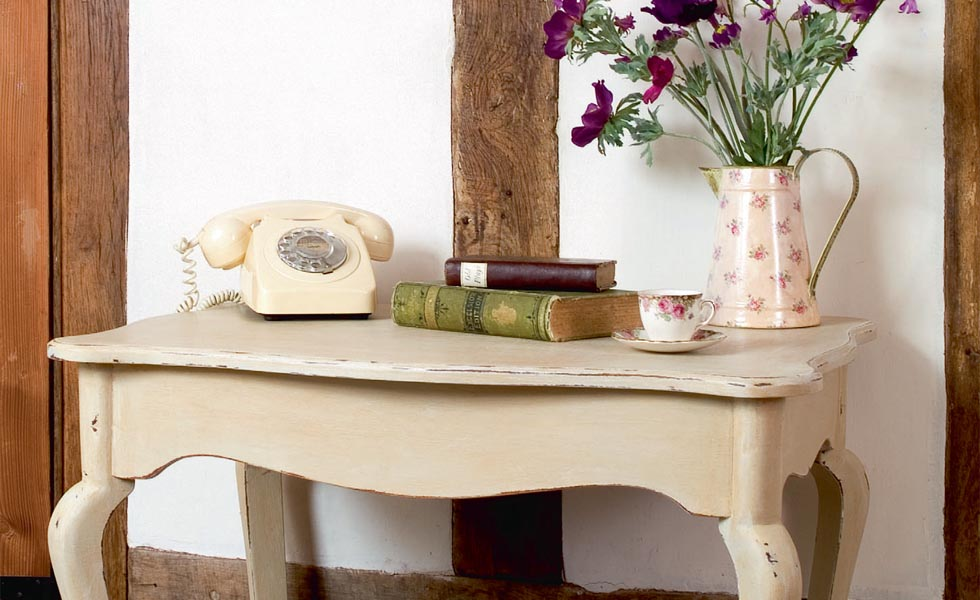 Upcycled table with distressed paint finish