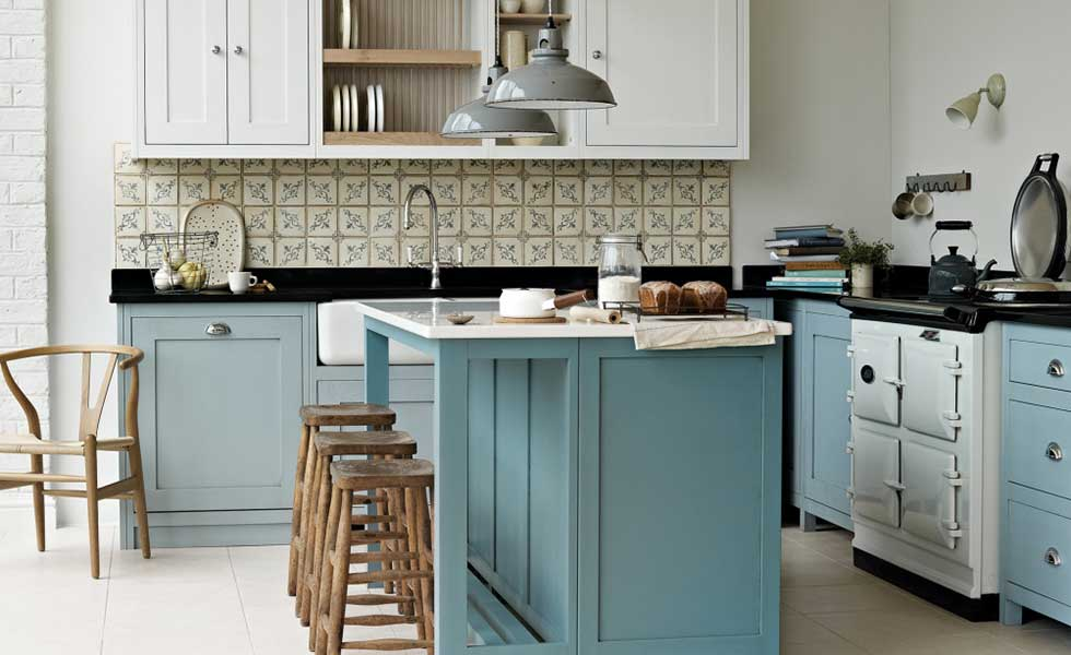 blue cabinets and island kitchen with wooden stools