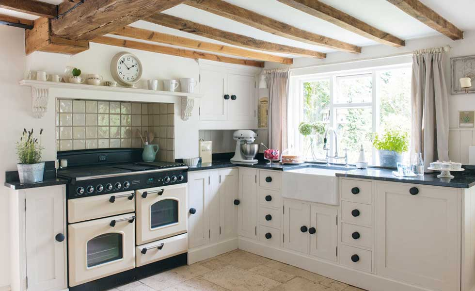 country kitchen with wooden beams and traditional range kitchen