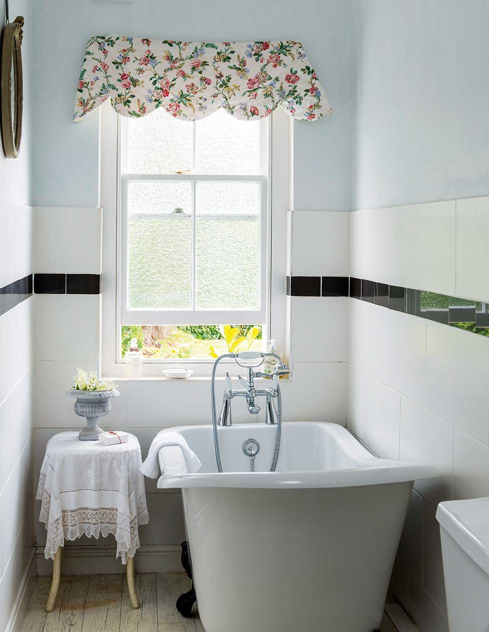 Narrow Bathroom With Slipper Tub And Obscured Glass Sash Window