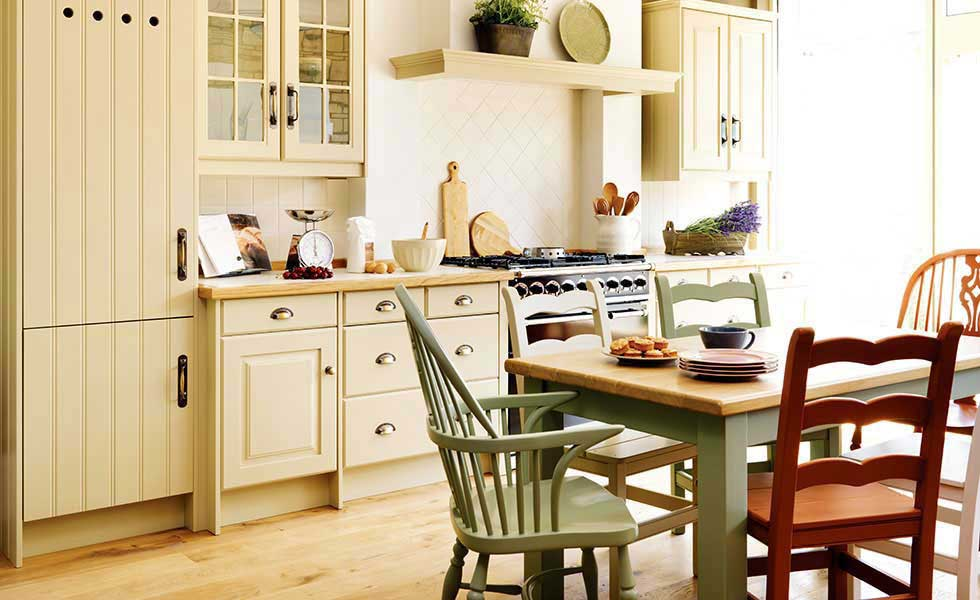 mismatched chair and cabinets kitchen