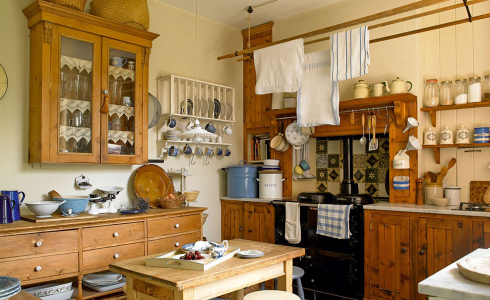 traditional victorian kitchen with wooden units, flour jars and accessories for baking