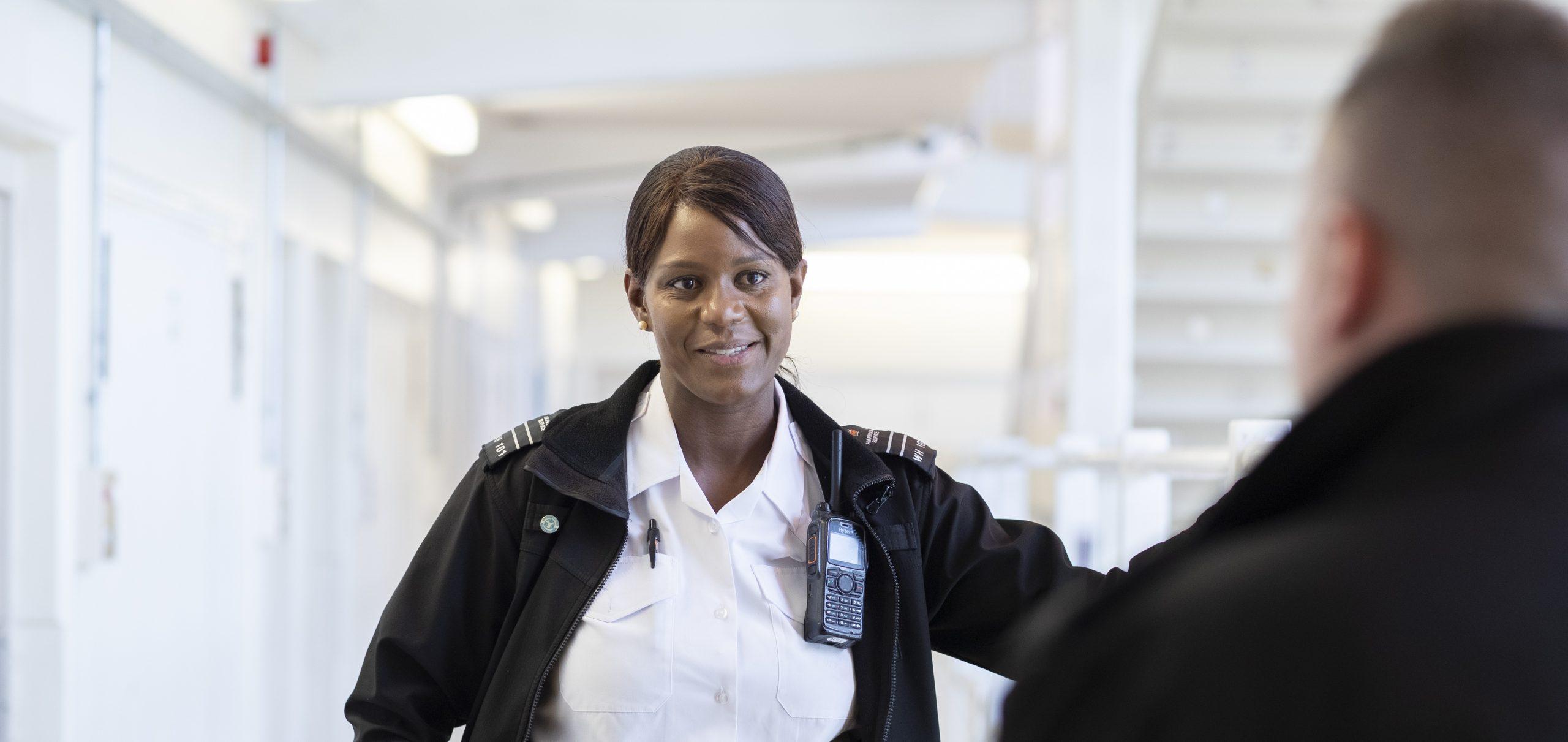 Smiling female prison officer