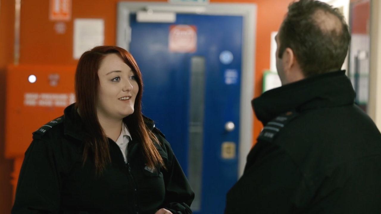 Prison officers talking in prison