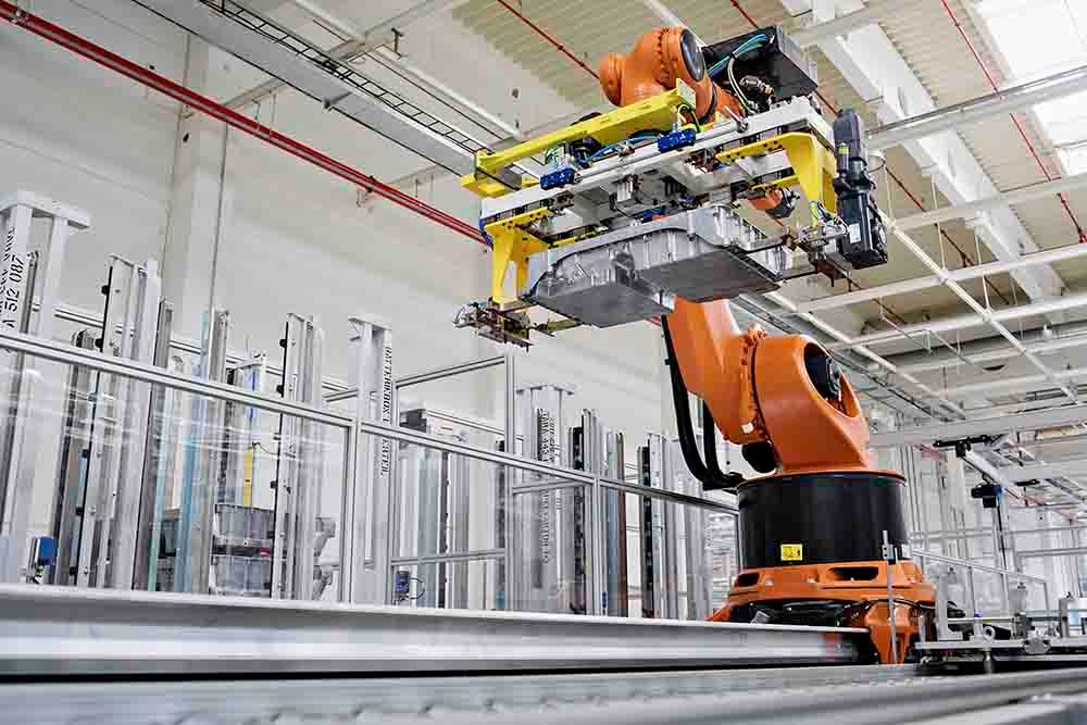 Robots on SKODA production line transporting heavy battery modules