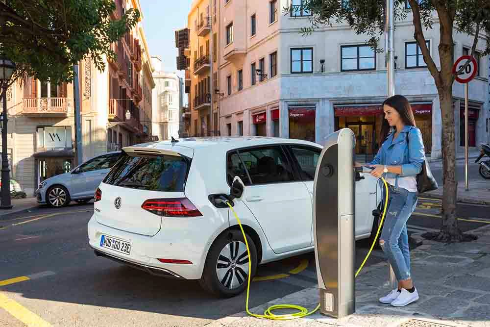 Volkswagen e-Golf on charge in street