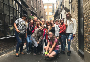 An SYC tour group exploring the London street that inspired Knockturn Alley