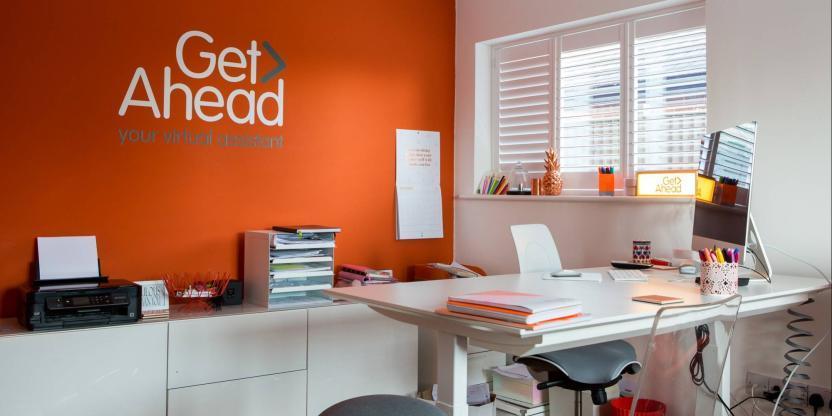 Rebecca Newenham, founder of Get Ahead VA keeps her standing desk tidy