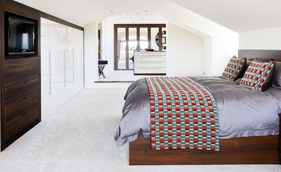 open plan bedroom with a dressing room and bathroom