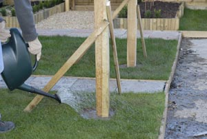 Nail wooden battens to each of the posts