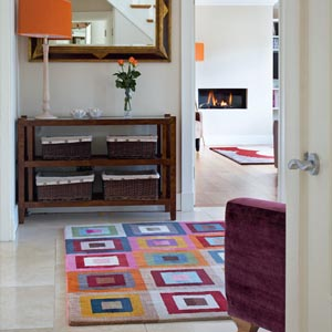 A colourful rug in the hallway