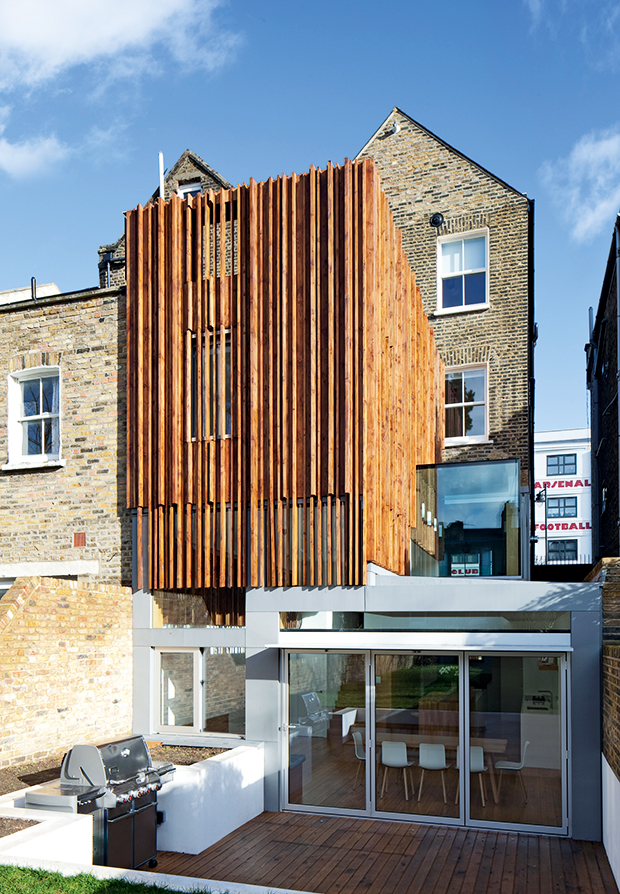 Sculptural timber extension by Paul Archer Design