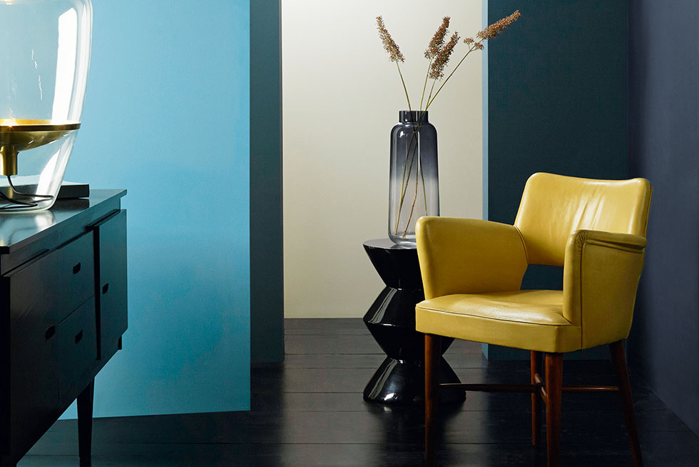 blue-wall-yellow-chair