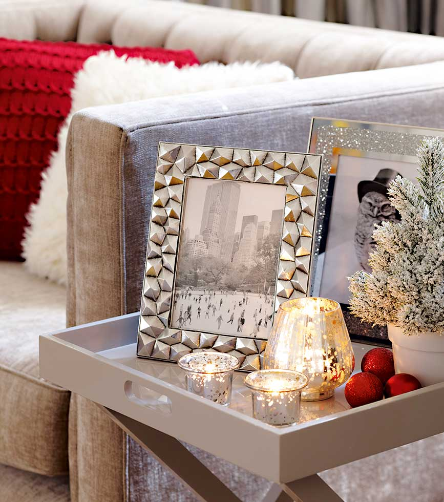 Display metallic frames and candle holders together on a side table for maximum impact.