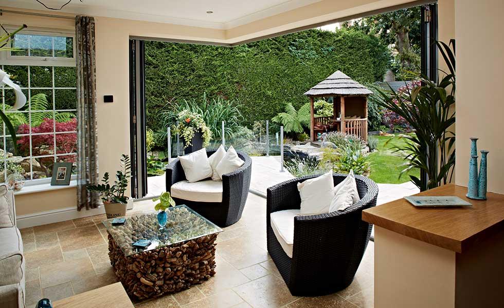 open corner with bi-fold doors to garden from living room