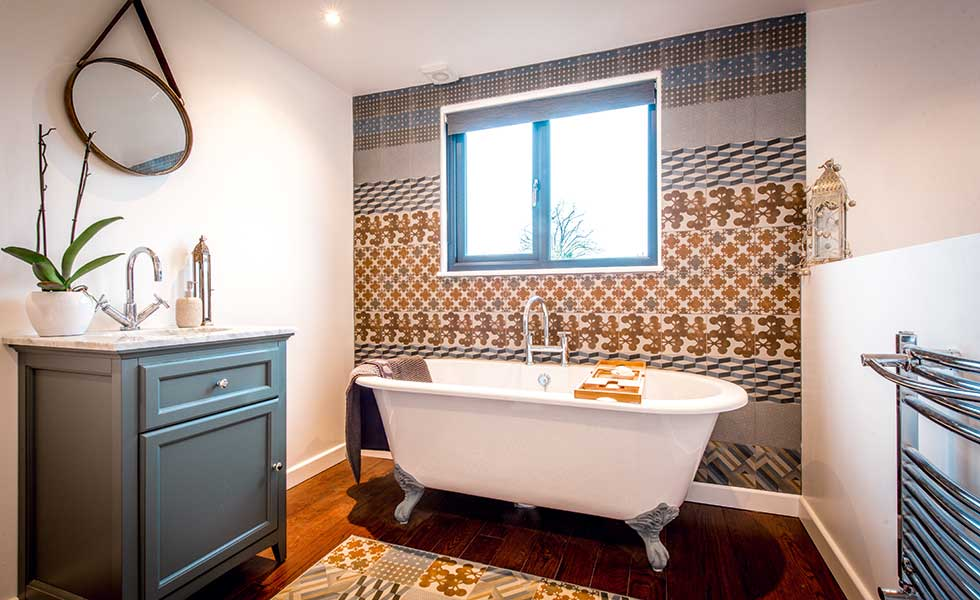bathroom in loft conversion with spanish tiles