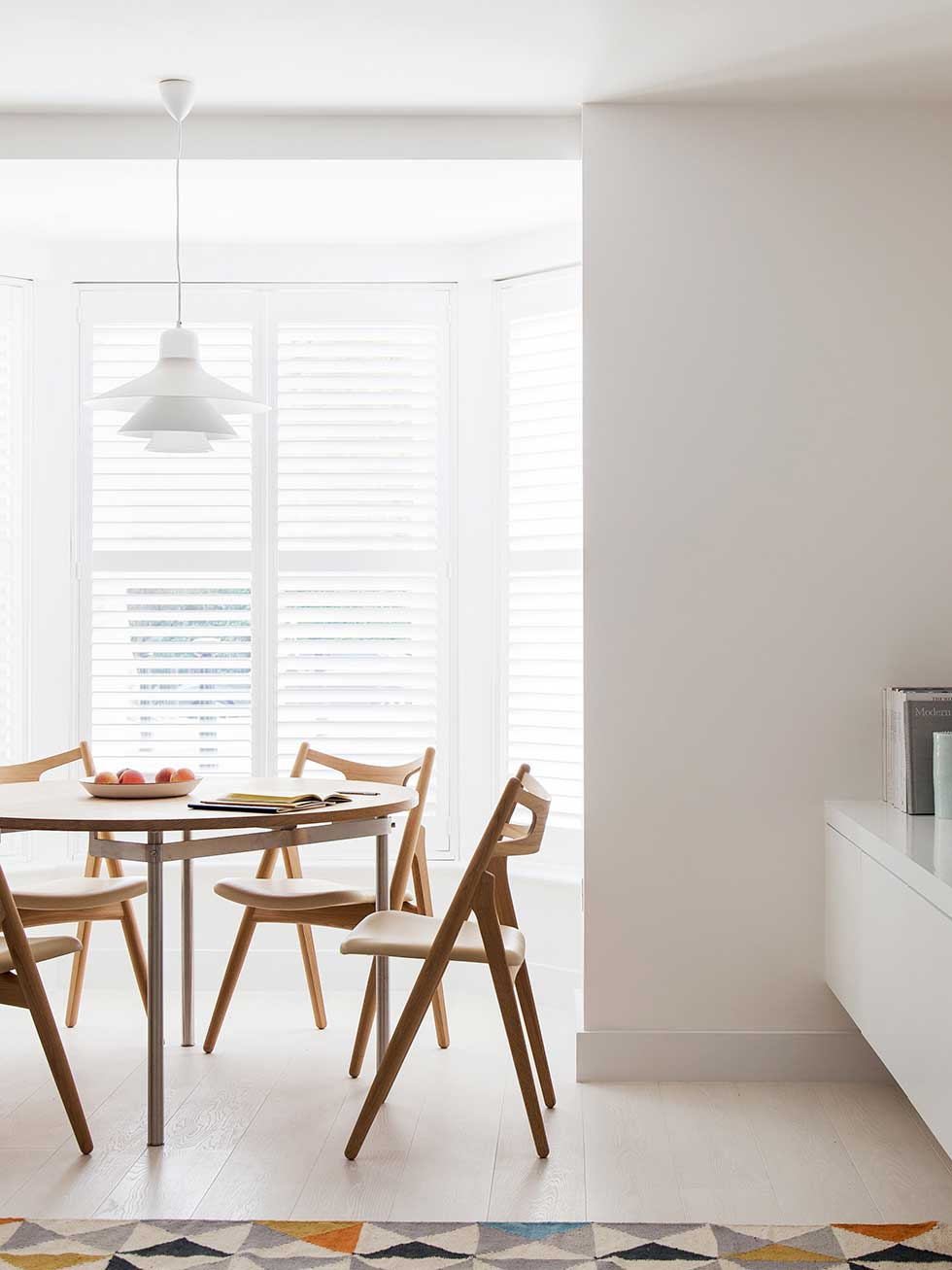 london flat dining area with floating storage