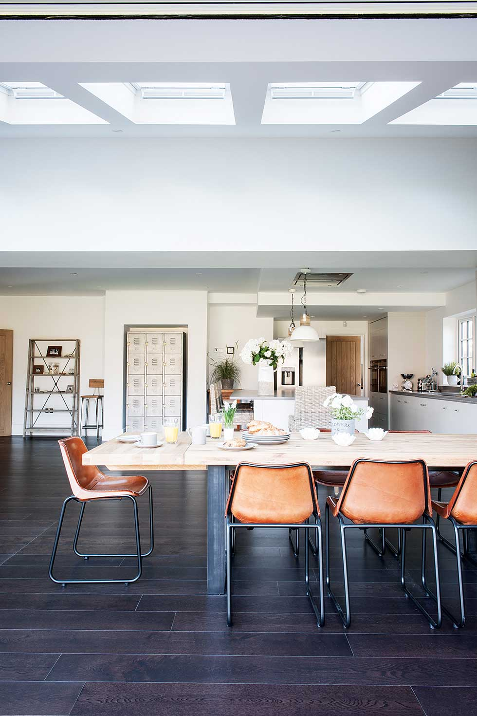 Industrial kitchen extension dining area rooflights leather chairs