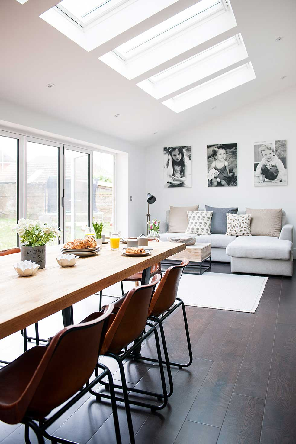 Industrial kitchen extension dining living rooflights with sofa and table