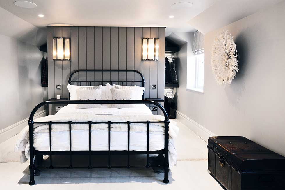 scandinavian style master bedroom suite metal bed timber wall cladding grey