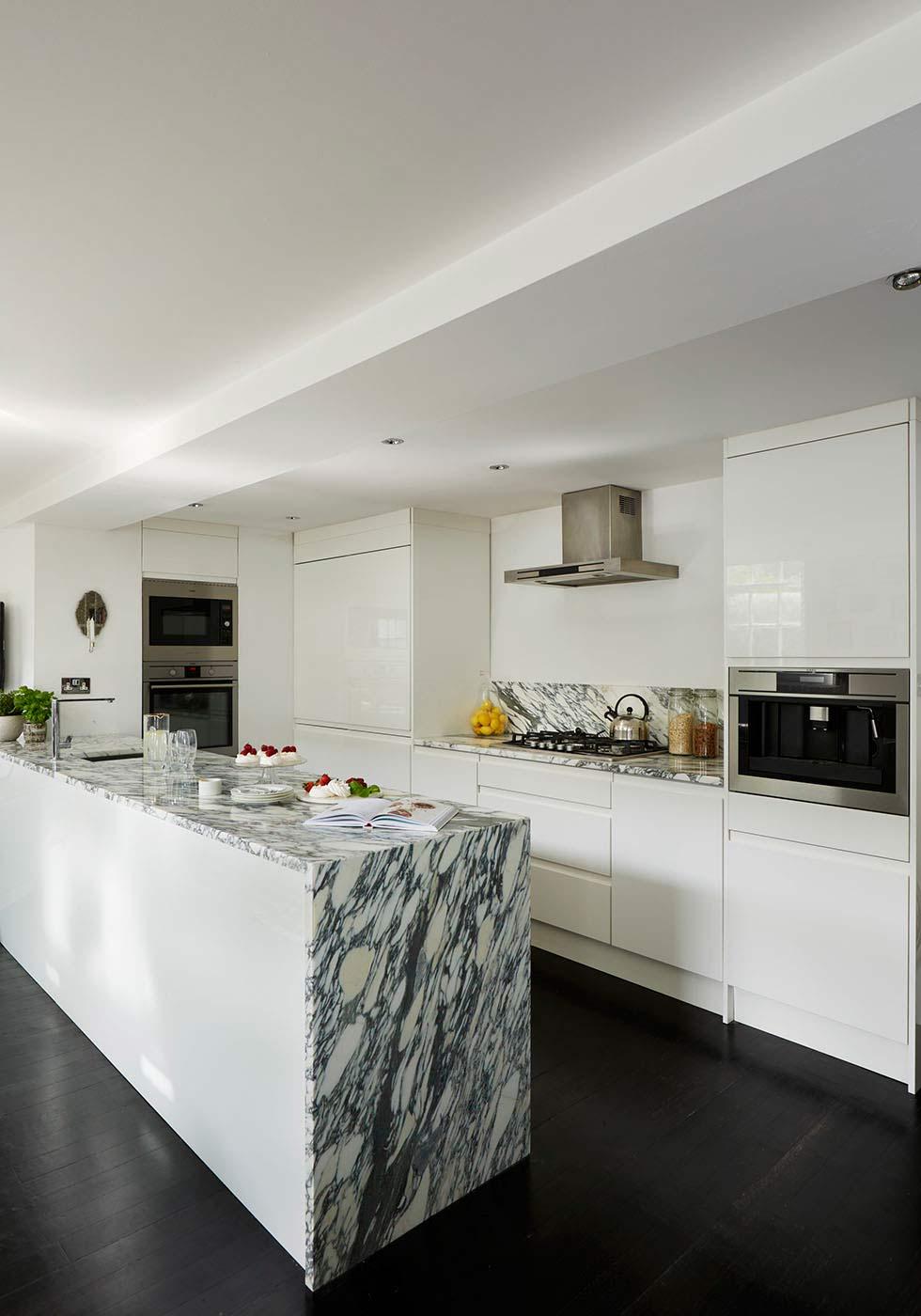 luxury contemporary kitchen under a mezzanine in a school conversion