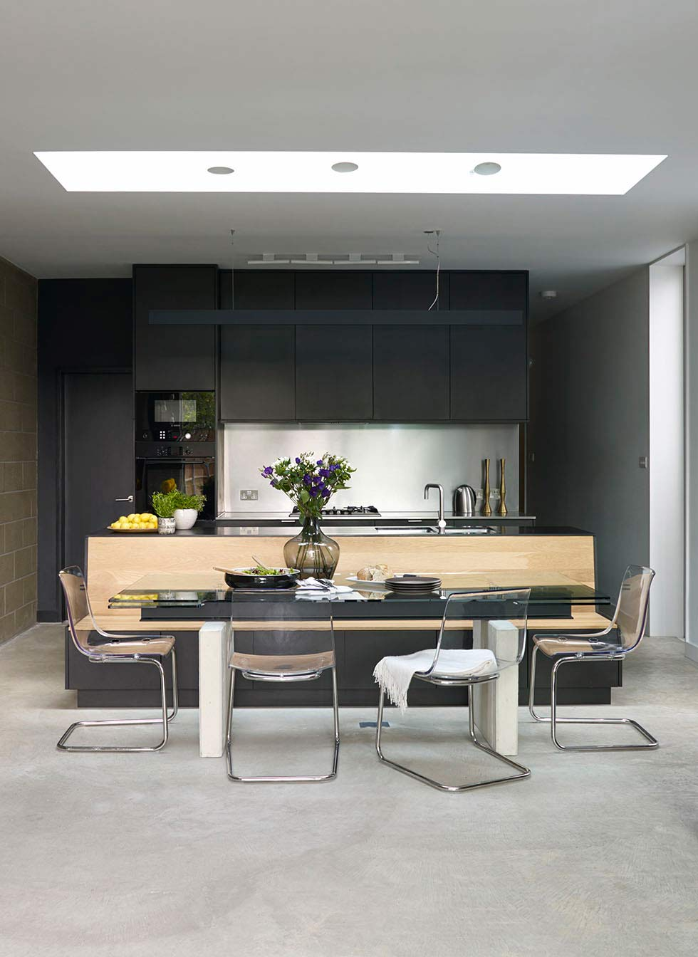 contemporary black kitchen with industrial touches