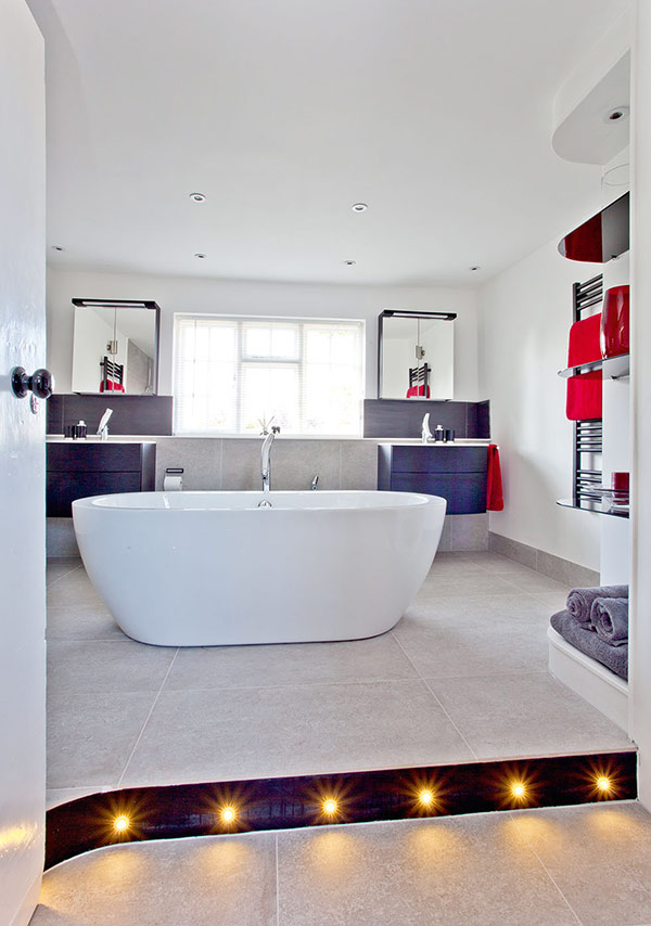 how to choose bathroom lighting. bathroom has spotlights in the ceiling while a plinth with recessed lighting adds glamour and how to choose
