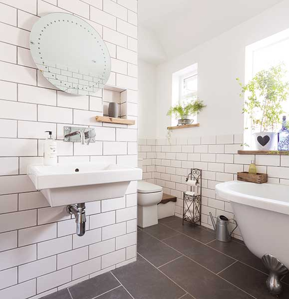 metro tiled industrial style bathroom in a Victorian terraced house